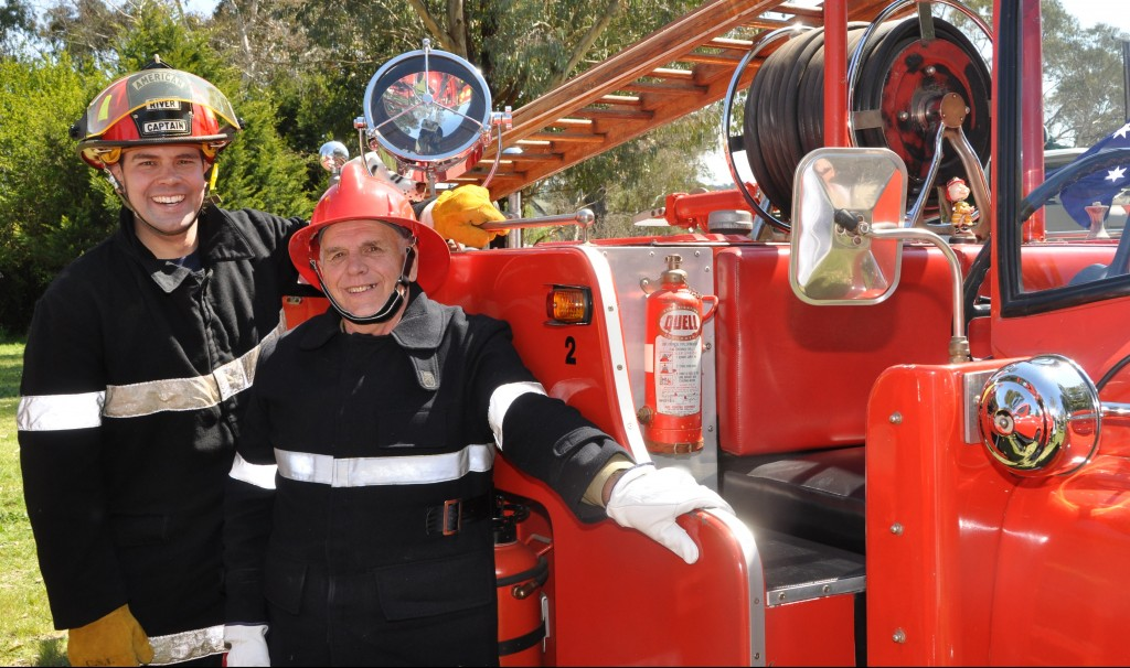 Brenton and his father Leigh Ragless with Leigh's  vintage 1961 fire engine
